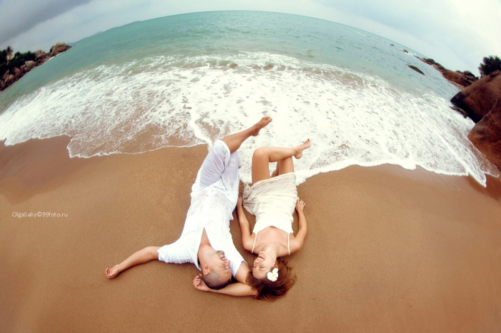 Wedding man and a woman lying on the beach