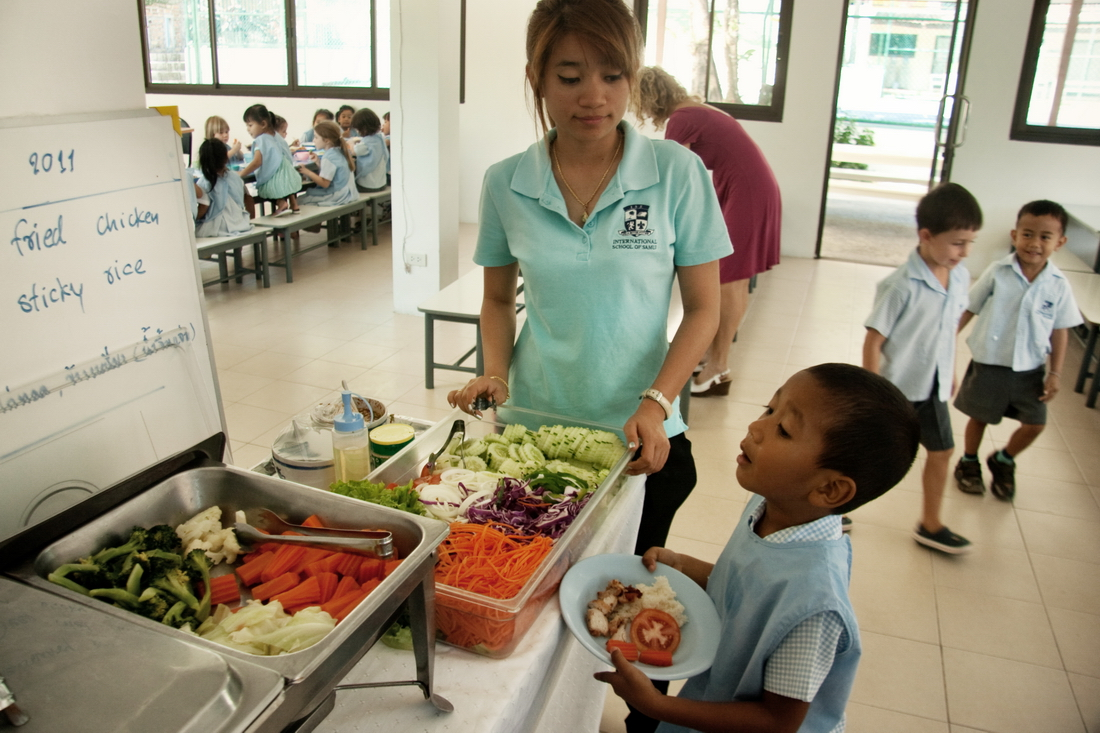 boy choose the food in kindergarten Ko Samui