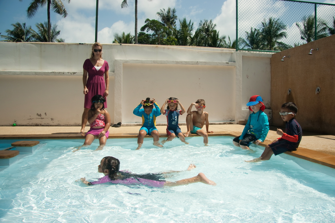 Children swim in the pool at the kindergarten Koh Samui