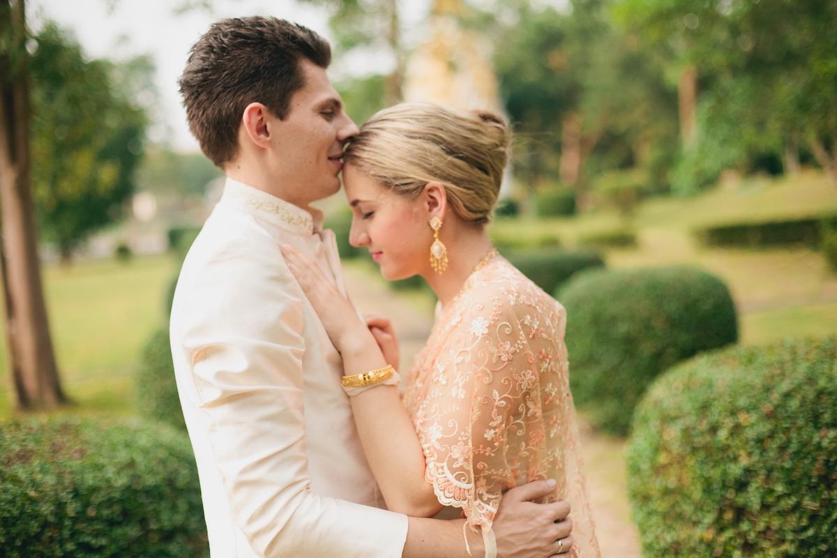Newlyweds in a Thai wedding dresses