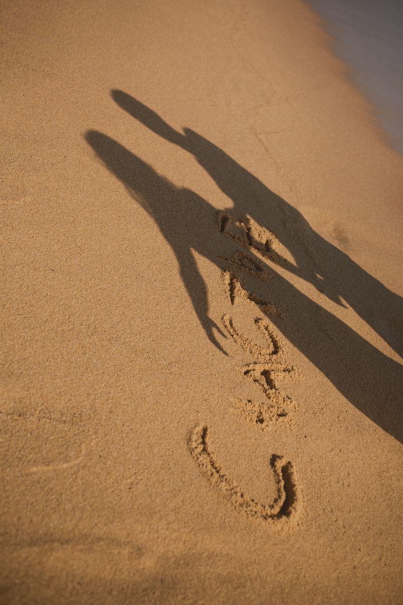 The letters and shadows on the sand
