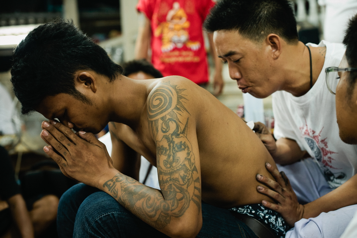 Thailand monks make a tattoo Sak Yant
