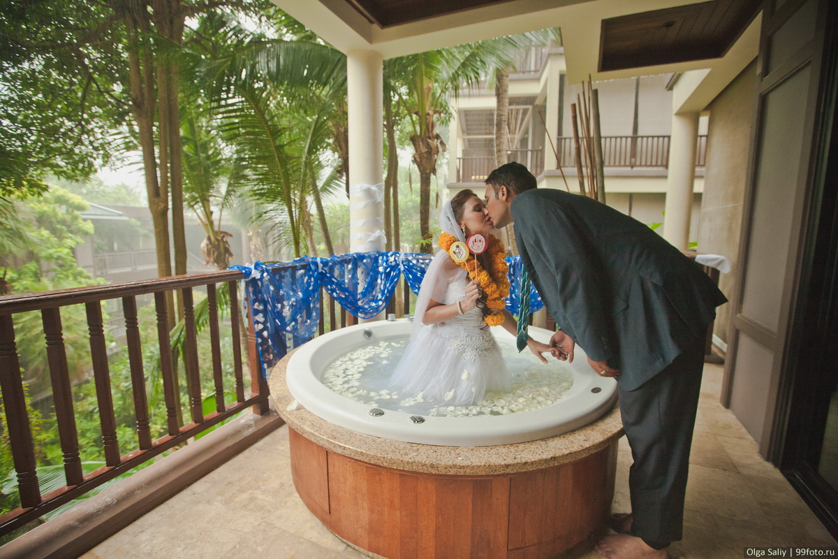 The bride and groom in the jacuzzi