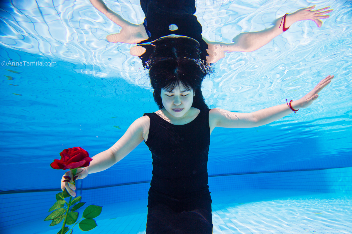 Beautiful young Asian woman under the water