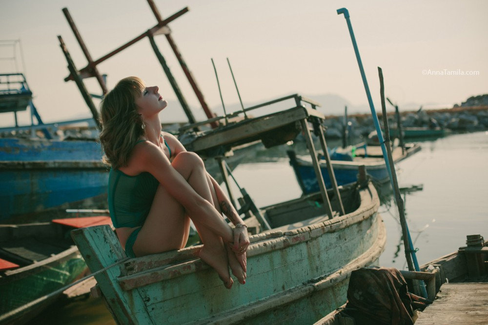 Beautiful woman on the old boat