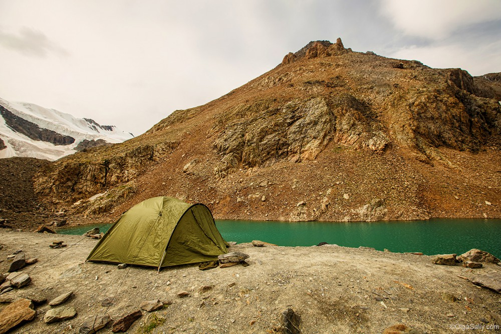 Tent in Altai Mountains, blue lake, Aktru