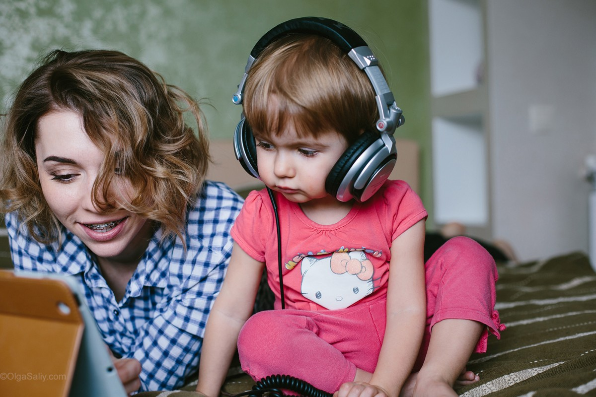 Mother and little girl listening music