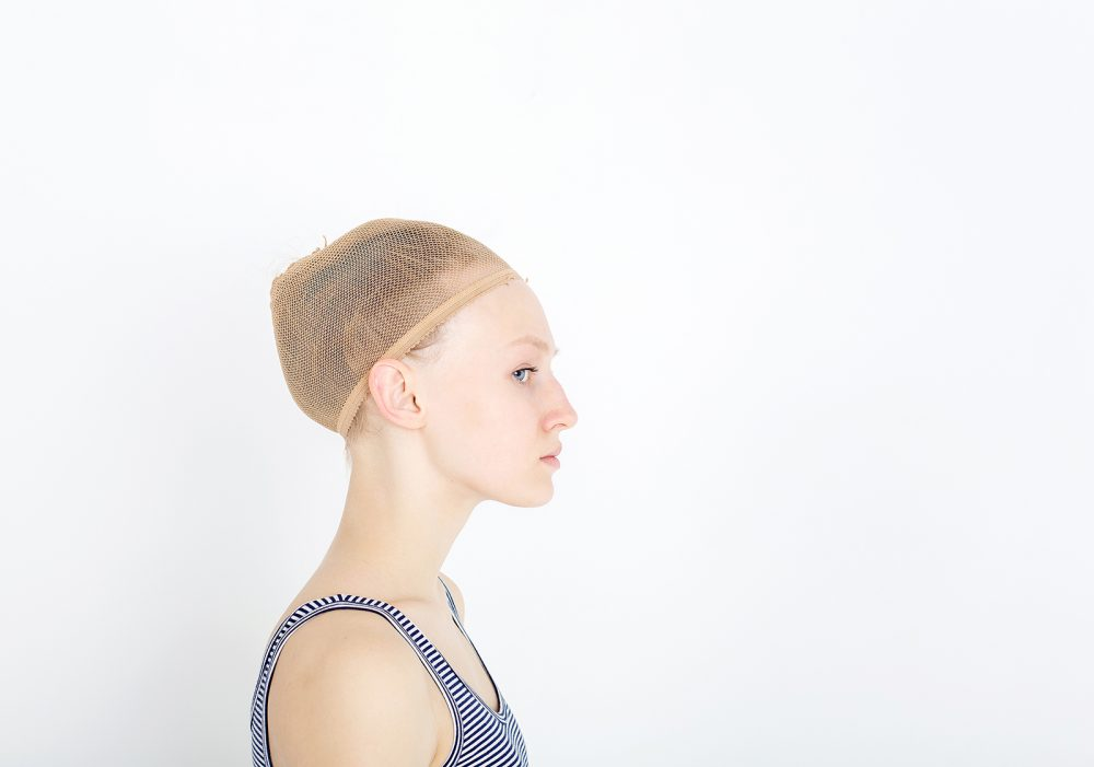 Woman wearing wig cap. Hair treatment concept