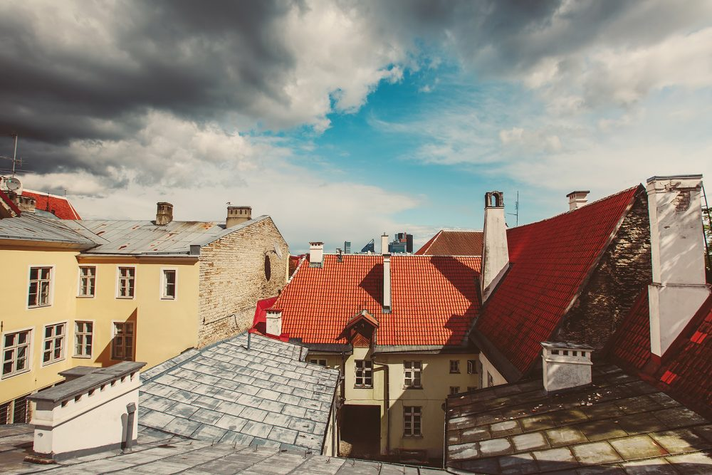 Roofs and clouds over European city skyline