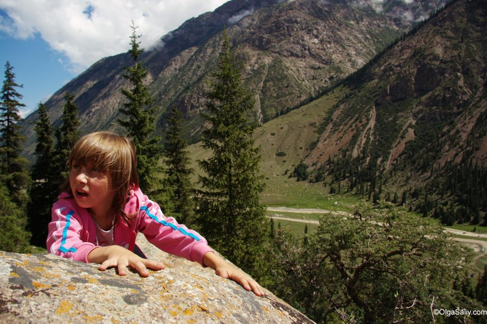 A little girl surrounded by Kyrgystan gorges, Issyk-Kul